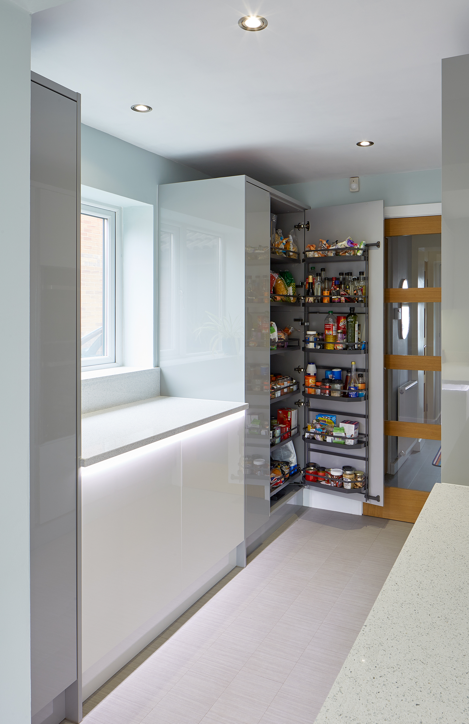 Bespoke fitted kitchen in porter silver grey and porcelain kitchen.