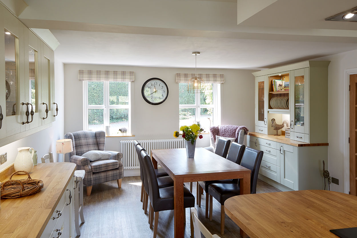 Hardwood dining table for four in an open plan kitchen diner.
