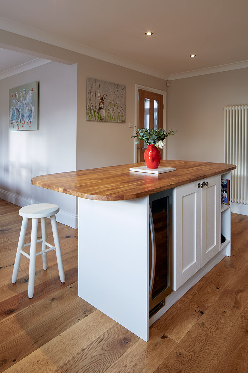 Hardwood breakfast bar with overhanging lip for seating.